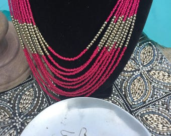 Pink and gold multistrand necklace with matching earrings