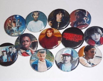 Stranger Things Cast and Logo Button Sets, Millie Bobby Brown as Eleven, Gaten Matarazzo as Dustin, Winona Ryder as Joyce, and more