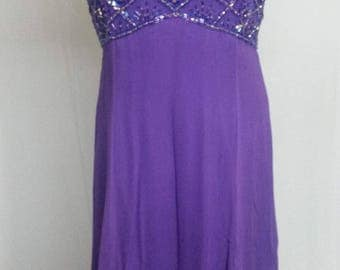 Dress with rhinestones on top