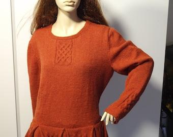 Celtic sweater with pleated peplum.