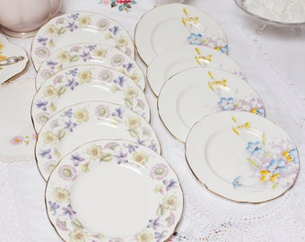 """Collection of 8  tea plates with: English bone china plates by Paragon ( handpainted) and Duchess """"Springdays. All in Lilac shades."""