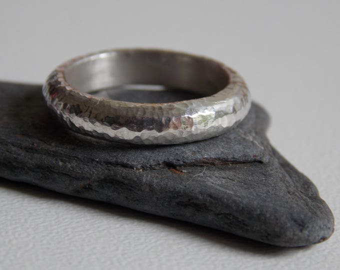 wedding ring in silver with a hammered effect. Mixed wedding ring