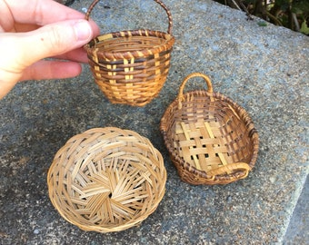 Three wee woven baskets