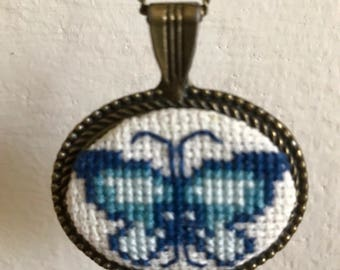 Hand-made Cross Stitch Butterfly Necklace with Oval Silver Tone Frame and Chain
