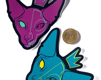cat with skull and crown vinyl sticker in teal and magenta
