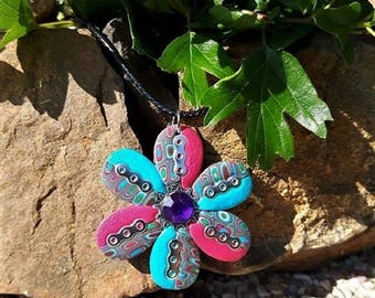 Flower necklace blue and pink with a rhinestone heart, made of polymer clay.