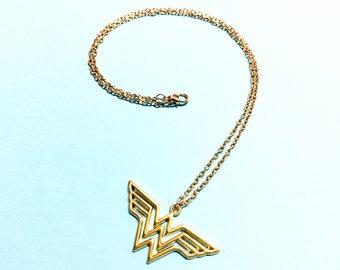Wonder Woman Necklace - Gold logo shaped pendant charm. Super hero jewelry. Gold Wonder Woman Necklace. Beautiful, minimal necklace.