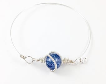 Silver bangle with Blue stone