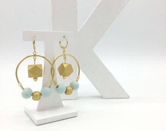 Dangling earrings with Scandinavian inspired Golden