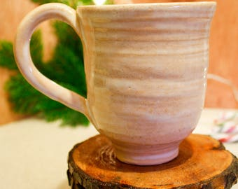 Hand made, wheel thrown ceramic mug with Opalescent glaze.