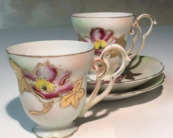 Two little German -  hand painted - porcelain demitasse cups and saucers.