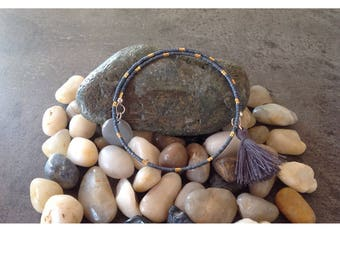 Beads miyuki and gray tassel, sequin gray enamel.