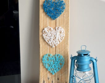 String art on pallet beanie with 3 hearts
