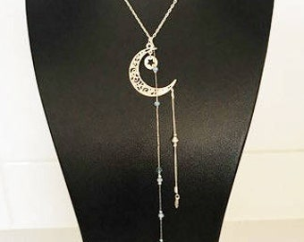 Necklace half long with a mixture of silver plated chain and Blue Crystal beads