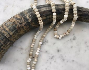 Long strand of old white Padre beads from Ethiopia