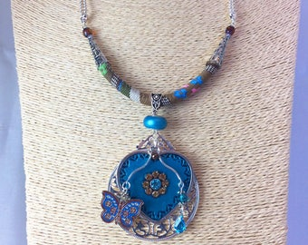 Turquoise enameled metal heart, ethnic bead and Butterfly Necklace