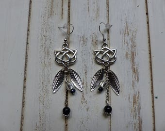 Black and silver symbol dangle pierced earrings and leaves
