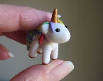 Gloria the rainbow polymer clay unicorn