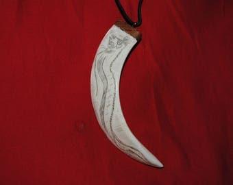 Boar tusk necklace, oarfish scrimshaw