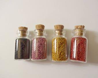 Vials of microbeads (x 4) gold, red, black, purple - glitter - glitter - rhinestones - embellishment