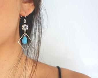 Handmade asymmetric earrings blue crystal with silver flowers