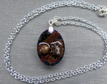 crystal resin pendant containing seashells from Scottish beaches on a silver plated bail and chain