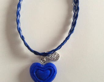 Leather strap and blue heart