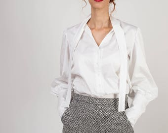 Blouse white, Puffed sleeves, Extra-large buttoned cuffs,Front knot, V-neck