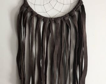 SOLD ********************medium brown buffalo hide wrapped dreamcatcher with ammonite centre, long buffalo hide fringe