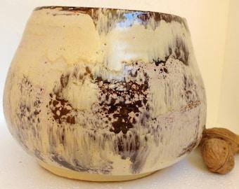 Glazed ceramic bowl.