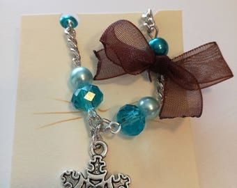 Blue beaded bracelet and snowflake charm