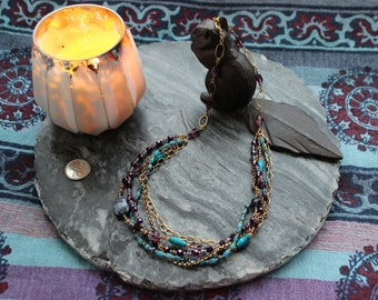 Alluring Multi-stranded necklace  with mystic deep purple hues