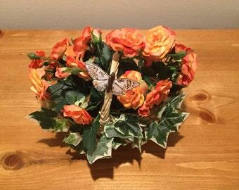 Basket of orange mini roses