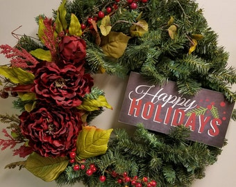 "24"" evergreen wreath with happy holidays sign and artificial flowers"