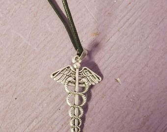 Larger nurse necklace pendant on cord