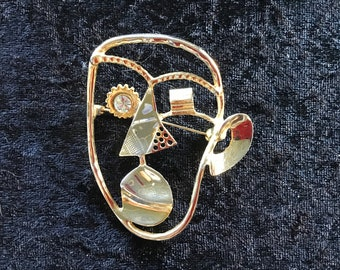 Abstract face brooch