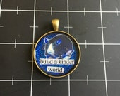 """Blue Rat Pendant, """"Build a kinder world"""", 50% goes to the current focus charity"""