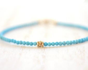tiny turquoise beaded bracelet with gold vermeil detail. delicate string bracelet. minimalist stacking bracelet. turquoise jewelry
