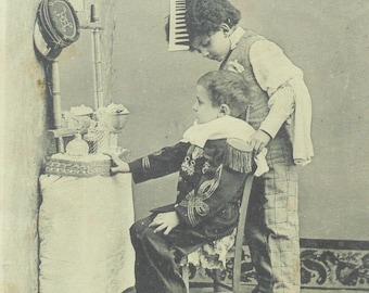 French Antique Postcard -  Le Petit Coiffeur (The Little Hairdresser)