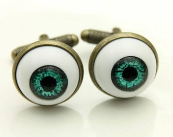 Cufflinks green eyes (1616)