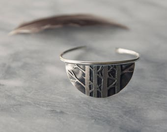 Half moon cuff bracelet, dense bare birch forest