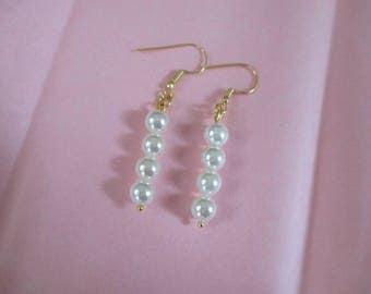 Shell pearl earrings wuth gold plated shepherd hooks.