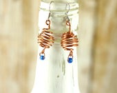 Round spiral cage earring...