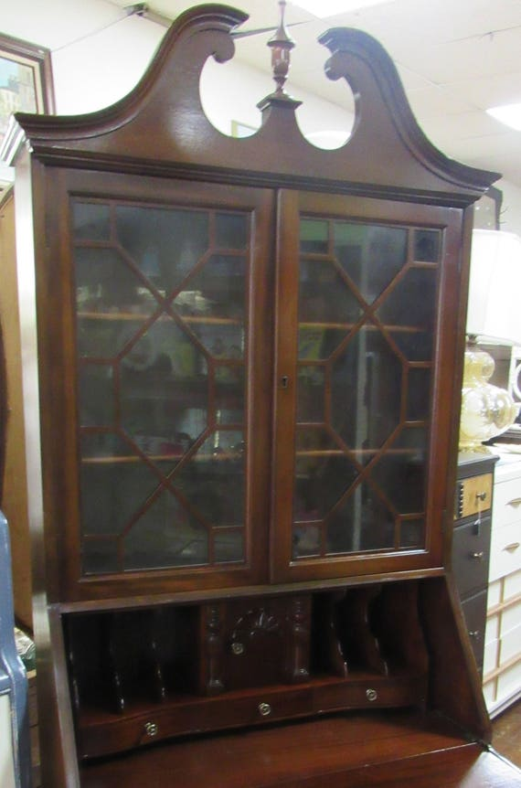 Mahogany secretary bookcase with serpentine drawers & secret compartments