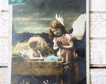 Antique nativity postcard - Christmas Jesus crib hay, little girl angel wings, stars Bethlehem, sky night evening, french hand tinted, 1900