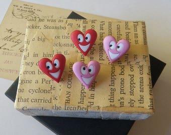 Four Goofy Heart Buttons Plastic NOS