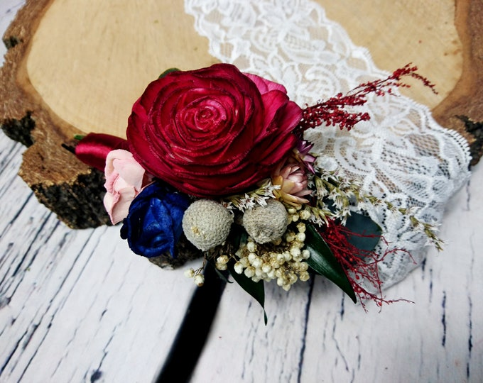 Boho wedding boutonniere in shades of wine, blush pink and navy with preserved eucalyptus