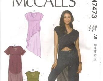McCall's 7473 Size 6, 8, 10, 12, 14 Women's short sleeve hi-low or asymmetrical hem top / tunic sewing pattern.  Top with flounce, long back