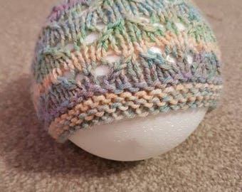 Baby beanie hat, Hand knitted in a lacy eyelet stitch