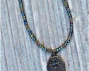 Skeletons closet locket necklace